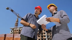 Construction workers, partnership - stock footage