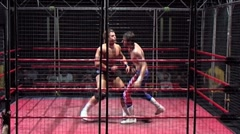 Cage match - Pro wrestlers exchanging punches and strikes Stock Footage