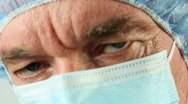 Stock Video Footage of Surgeon Face Close-Up Bad News