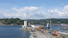 Freight ship leaves docks in Kristiansand, time lapse Stock Footage
