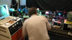 Laboratory assistant set equipment in physics lab, time lapse Stock Footage