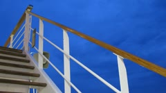 Ladder on cruise liner deck at evening, time lapse Stock Footage