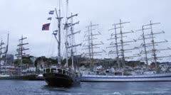 Ship docks in front of MIR barque to sea regatta - stock footage