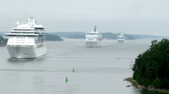 Cruise liners manoeuvring between rock islands in mist, time lapse Stock Footage