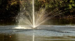 Close up of small water fountain in the pond - stock footage