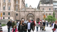 People pass in front of Riksdag Stock Footage