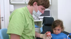 Brave girl in dental clinic chair, time lapse Stock Footage