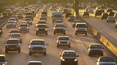 Freeway at dusk with oncoming L.A. traffic - stock footage