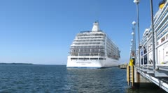 SEVEN SEAS VOYAGER cruise liner leaves port Stock Footage