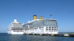 SEVEN SEAS VOYAGER and COSTA LUMINOSA liners at bay Stock Footage