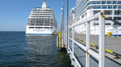 Two cruise liners stationed at bay Stock Footage