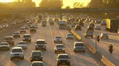 Freeway at dusk with oncoming L.A. traffic Stock Footage
