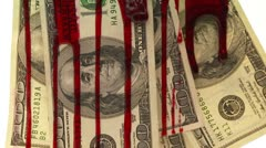 Close up of blood dripping down a group of one hundred dollar bills Stock Footage