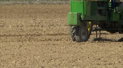 Tractor implement working ground CU - stock footage