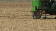 Stock Video Footage of Tractor implement working ground CU