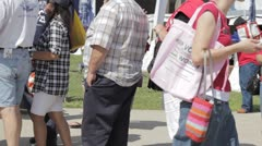 HD stock footage - overweight - obese people in line, others walk by - stock footage