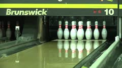 Medium shot bowling ball knocking down ten pins on alley for a strike. Stock Footage