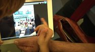 Childrens touching and playing with Digital Tablet (iPad). Stock Footage