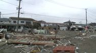 Japan Tsunami Aftermath - Truck Smashed Into Side Of House Stock Footage