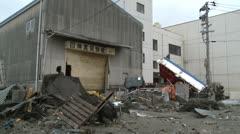 Japan Tsunami Aftermath Trucks Smashed Against Warehouse Stock Footage