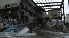 Japan Tsunami Aftermath - Damage To Industrial Buildings In Port - stock footage