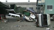 Japan Tsunami Aftermath - Vehicles Lie On Top Of Each Other Stock Footage