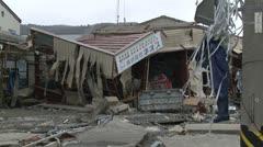 Japan Tsunami Aftermath - Flattened Industrial Building Near Coast Stock Footage