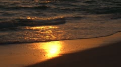 The reflection of the setting sun on the wet sand Stock Footage