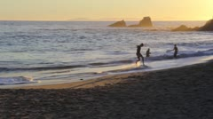 Skimboarder Doing Tricks on the Beach At Sunset Time Stock Footage