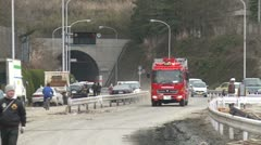 Japan Tsunami Aftermath - Fire Trucks Race Along Street - stock footage
