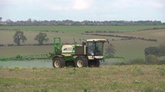 crop spraying - weedkiller - valley in background with soundtrack - stock footage