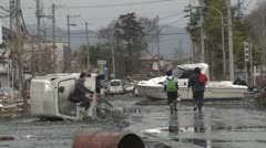 Japan Tsunami Aftermath - Vehicles And Boat Block Street Stock Footage