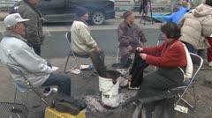 Japan Tsunami Aftermath - Survivors Sit Around Fire On Street - stock footage