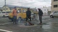Japan Tsunami Aftermath - Survivors Stand Around Fire On Street Stock Footage