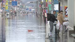 Japan Tsunami Aftermath - Tidal Flooding In Downtown Ishinomaki City - stock footage