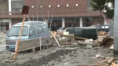 Japan Tsunami Aftermath - Smashed Cars Lie In Mud In Ishinomaki City Stock Footage