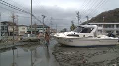 Japan Tsunami Aftermath - Boat Lies In Street In Ishinomaki City - stock footage