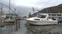 Japan Tsunami Aftermath - Boat Lies In Street In Ishinomaki City Stock Footage