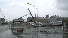 Japan Tsunami Aftermath - Cars Lie In Mud In Street In Ishinomaki City - stock footage