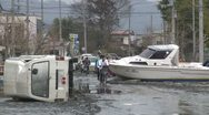 Japan Tsunami Aftermath - Vehicles And Boat Block Street In Ishinomaki City Stock Footage