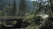 Car goes over a bridge in the mountains Stock Footage