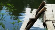 Wooden bridge on the river Stock Footage