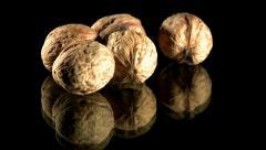 Putting walnuts Stock Footage