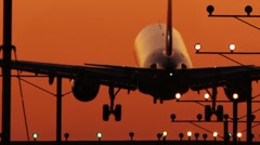 Twin Engine (Boeing 767) Sunset Silhouette Landing audio Stock Footage