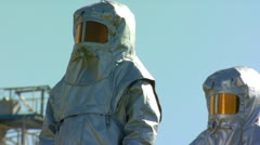 People in protective suits - stock footage