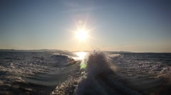 Sunset with fast high waves behind boat with CANON Mkll Stock Footage