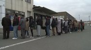 Stock Video Footage of Japan Tsunami Aftermath - Survivors Queue Outside Shop For Supplies