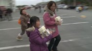 Stock Video Footage of Japan Tsunami Aftermath - Survivors Collect Supplies From Factory