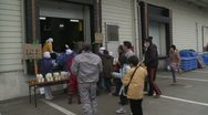 Japan Tsunami Aftermath - Survivors Collect Supplies From Factory Stock Footage