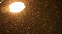 Plentiful snowfall in lamp light Stock Footage